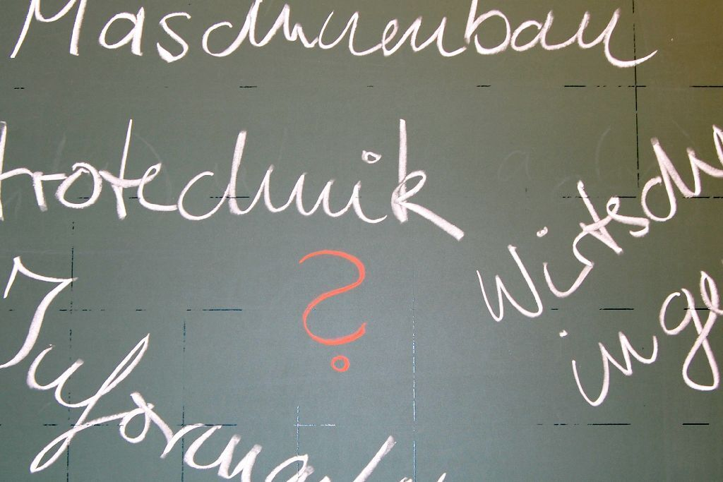 Names of courses of study written on a chalkboard